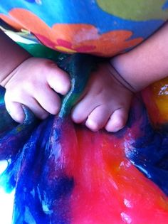 1 1/2 cups of clear glue + 1 1/2 cups of liquid starch=goo! This blogger also added food coloring for a rainbow look.