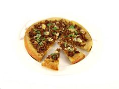 Get Caramelized Onion, Sausage and Basil Pizza Recipe from Food Network.  Favorite! Make without butter and sub feta for Gorgonzola/BC.