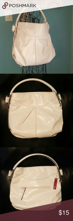 White handbag from WILSON'S LEATHER Very cute white handbag purchased from Wilson's Leather. Brand new with tags still attached. Purse has one handle, silver hardware & a camel colored interior. Lots of room! Zipper picket on the back side. Wilsons Leather Bags