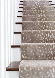 A gray animal print stair runner accents a white staircase boasting stained wood… – carpet stairs White Staircase, Staircase Runner, Staircase Design, Stair Runners, Staircase Diy, Stair Rug Runner, Staircase Landing, Staircase Remodel, Hallway Runner