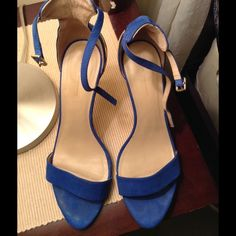 Zara blue suede heels size 40 For sale are a pair of Zara blue suede shoes ankle strap in size 40. Beautiful shoes that have some wear to them which is reflected in the price. The heels have a few scratches and the insole has the toe print as shown in pics. The strap is good. The heels could use a lift. They fit like a size 8.5. Zara Shoes Heels