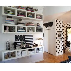Awesome polka dot wall and cool Ikea sideways media storage for bookshelf.  Love everything but I'd replace the flag.  :)