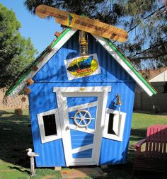 Surf shack playhouse... my boys would never be indoors again
