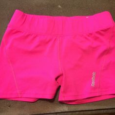 Reebok spandex shorts HOT pink reebok spandex shorts, size small. Super cute! Only worn a couple of times, excellent condition! Reebok Shorts