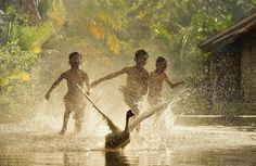 Splash - Children having fun in the stream in their village. Taken from west Java, Indonesia