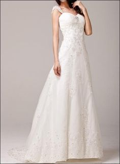 Gorgeous lace gown with appliqués and straps