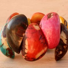 Multi-color Tagua Nut Beaded Bracelet | Fabulous - straight from the Amazon - http://www.artisansintheandes.com/beaded-bracelets-leather-ladies/beaded-bracelets-multi-tagua-nut