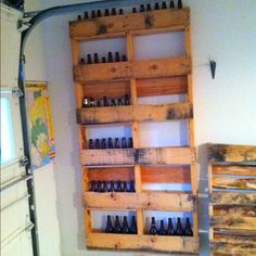 Garage wall homebrew holders upcycled from pallets.