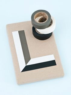 handmade card ... clean and simple ... graphic design ... solid black and white tape on kraft ... quick and easy notecard ...