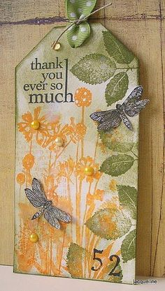hand created tag ... color layering ... vintage look ... olive and gold ... leaves and meadow flowers .. dragonflies on top ... pearls matching flowers ... sentiment ... delightful!!