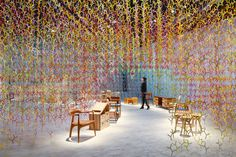 "French designer Emmanuelle Moureaux has created a massive installation of branches for both the Paris and Tokyo events called Wood Furniture Japan Award 2016. With over 20,000 individual pieces in over 100 color, the cumulative mass of the installation is a web-like form that defies the stark industrialization of many craft show. This piece, and others that the artist has made, explore the intensity of color that she experienced during her first visit to Tokyo. The artist says, ""Each module…"