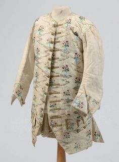 Long-sleeved waistcoat, probably France, c. 1730. Cream silk faille brocaded with floral sprays in coloured silk and silver thread.