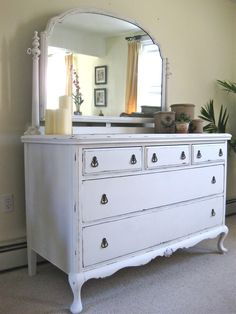 Antique dresser refinished in white. Also distressed.
