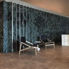 2015 recap 2/5. For our commercial project choice, a luxury residential lobby in Boston. Stone accordion wall in Empress Green marble and unfilled travertine, end-cut bleached white oak floors. Chairs are #RodolfoDordoni. Table is #PieroLissoni. Both for Cassina. #ashnyc