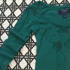 American Eagle long sleeve tee Long sleeve scoop neck tee by American Eagle. Vine/flower print on the front and down the right arm. American Eagle Outfitters Tops Tees - Long Sleeve