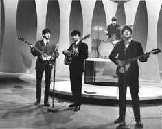 Ed Sullivan TV show assistant, Vince Calandra (complete with Beatle wig) had to stand in for George Harrison at a rehearsal for the Beatles' first appearance in 1964. George was out sick with a sore throat.