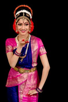 They are twin Indian Kuchipudi Dancers. They are graduating in this summer.