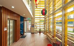 Mother Duck Childcare by Context | Yellow louvres blur boundary between inside and out whilst maintaining privacy