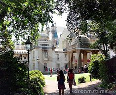 People visiting the  Royal Pavilion on a sunny day in Brighton.