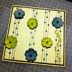 Draw som black lines on a white paper, glue some bling-bling and flowers. Then you have a simple and easy homemade card.