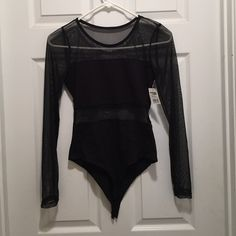 "NWT bodysuit shirt Super sexy bodysuit black sheer long sleeves and mid section. Never worn pair it with a mini pencil skirt and the bottom closure will allow shirt to ""stay put"" Charlotte Russe Tops Blouses"