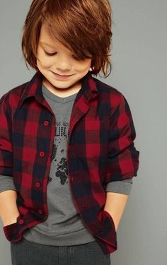 Cute red headed little man wearing red/black plaid shirt with grey shirt layered underneath.