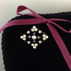 This lovely Victorian brooch features a delicate looking quatrefoil frame with 3 natural pearls to each foil. The central, larger natural pearl, is accented by 4 grain set diamonds & a further 4 claw set diamonds to the outer frame. 18ct yellow gold and silver a steal at $2,500