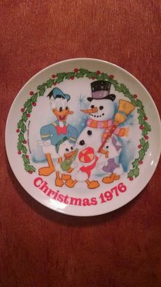 This Christmas 1976 Donald Duck Walt Disney collector plate is a rare and valuable Schmid limited edition collector plate. This beautiful Donald Duck collector plate will make a great gift for the Walt Disney lover that you know. Original box included. See more rare and valuable collector plates and beautiful clocks at giftygold.com. Make Gifty Gold your single source for your gift-giving needs. Gift wrapping available upon request.   eBay!
