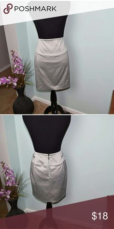 Express Sexy Stretch Platinum Colored Skirt In excellent like new condition. Beautifully made and very flattering. Express Skirts Midi