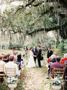 wedding ceremony with flowers down the aisle http://trendybride.net/flower-petals-down-the-aisle/ trendy bride blog