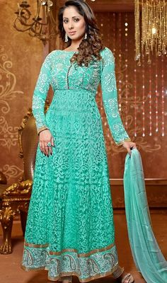 Mesmerise your onlookers like Sangita Ghosh in this light teal blue shade brasso georgette long Anarkali suit that parades brasso worked foliage designs, along with pita fashioned vine patterns on the yoke and paisley hemline.  #SangitaGhoshCollection