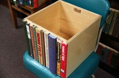 book spines glued to a box making a crafty and nifty hiding spot