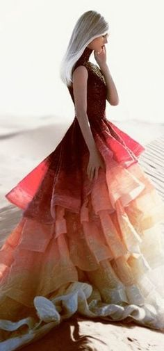 This dress reminds me of the hunger games ....... Something katniss would wear?!?:)