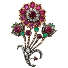 Ruby Emerald Diamond Gold Flower Pin. Decorated with circular Rubies and Emeralds and Old Mine cut diamonds, c 1880