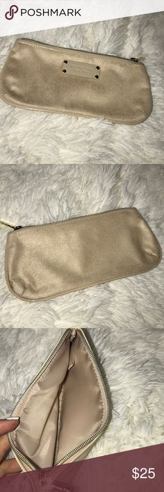 🌸Michael Kors clutch/make up bag🌸 Cream colored suede with gold tone zipper. Cream/light tan interior. Use as coin purse/ make up purse. Excellent condition. Michael Kors Bags Cosmetic Bags & Cases