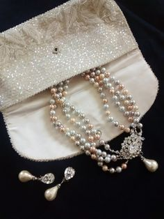 Check out this item in my Etsy shop https://www.etsy.com/listing/508063025/pearl-necklace-and-earrings-beaded-bag