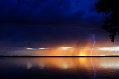 Lightning at Sunset. Photography by Judy Chandlee