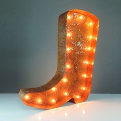The hand-crafted Light of America Cowboy Boot brightens the past of our rugged forefathers today. From weddings to bars to your child's bedroom, this piece plugs into standard outlets and works for any...  Find the Light of America Cowboy Boot, as seen in the Marquee Signs Collection at http://dotandbo.com/category/lighting/decorative/marquee-signs?utm_source=pinterest&utm_medium=organic&db_sku=VML0002