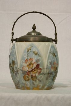 Washington Biscuit Jar with Raised Panels that look to maybe a flower bloom .