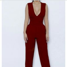 Burgundy Jumpsuit! Boohoo jumpsuit... only worn once! Actual jumpsuit has cap sleeves. In perfect condition! Plunge neckline... great fit! Pants Jumpsuits & Rompers