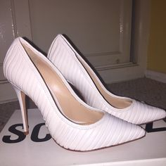 Schutz * Color: Ivory, * Ribbed leather upper, * Pointed toe, * Leather lining, * Leather sole with brushed goldtone raised logo lettering under arch, * 4'' covered stiletto heel, * All measurements are approximate, * Leather * Made in Brazil, SCHUTZ Shoes Heels