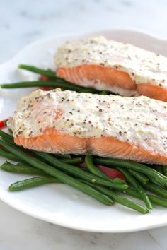 Moist sour cream salmon ready in 30min. spread a mixture of sour cream, whole ground mustard and parmesan cheese on top of salmon. Bake at 300 for about 15 minutes. http://www.inspiredtaste.net