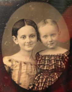 Both girls? We could assume so, the hair of both is parted in the middle. Still......it could be a brother and sister. Anyway, it doesn't matter, it's a cute Dag. mid 1840s. I luv the sweet grin on the left.