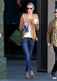 Rosie Huntington-Whiteley: skinny jeans, ankle boots, and beautiful tan leather jacket.