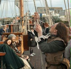 "BTS Outlander_Starz ~ Sam Heughan (Jamie) Caitriona Balfe (Claire) and Duncan Lacroix (Murtaugh), hopefully with a little help from the Cristabel's deck hands, they'll be on their way to France ~ filming of #Outlander ""Dragonfly in Amber"" season 2"