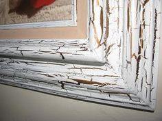 Paint wood surface with base coat latex or acrylic paint and allow to dry thoroughly.  Brush Elmer's Wood Glue on top of base coat. (A thicker coat results in larger cracks - apply a thinner coat for fine cracks.)  While glue is tacky, brush on top coat.  Dry completely.