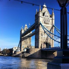 Historic Tower Bridge, a bascule and suspension bridge.  Find out scheduled opening times to let tall boats pass through at www.towerbridge.org.uk