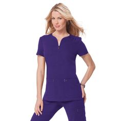 This koi Mara top in Grape is part of our Sapphire range which features super soft 4-way stretch material. This top has to be felt to be believed, it's as cosy as wearing your PJs yet looks professional and stylish. Try now for £29.99.#nursescrubs #dentistuniform #nurses #dentists #purplescrubs