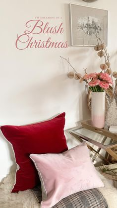Deep dark red velvet contrasting neutrals and pale pink Christmas living room