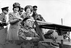 Princess Elizabeth inspects the Royal Artillery with her parents, Queen Elizabeth and King George VI, in 1945.
